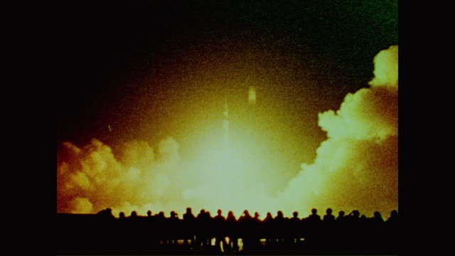 isaac asimov recalls the launch of apollo 17 at night causing the sky to glow orange as it flew to space - 1972 stock videos & royalty-free footage