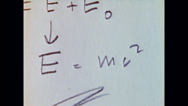 vídeos de stock, filmes e b-roll de isaac asimov talks about the whys of physics as the camera pans a handwritten sheet of energy equations - física