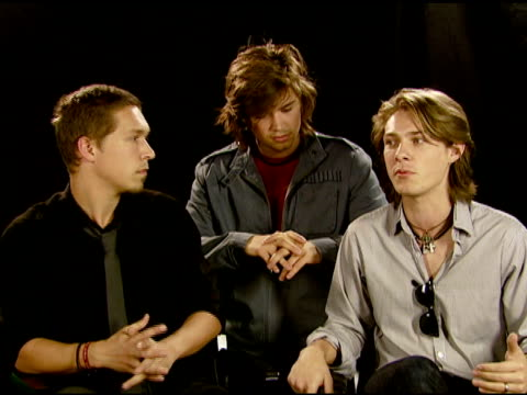 "isaac, zac, and taylor hanson on creating special ""walks"" at each city they perform in at the hanson, the city of west hollywood, and toms shoes join... - retrovirus video stock e b–roll"