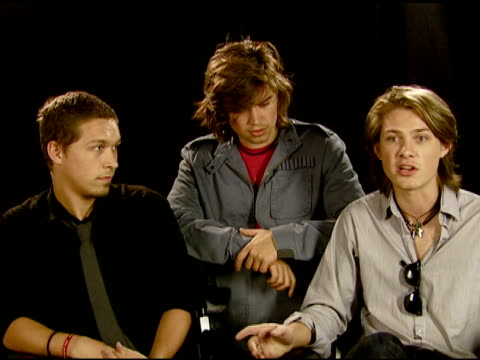 isaac, zac, and taylor hanson on their generation taking action on behalf of others at the hanson, the city of west hollywood, and toms shoes join... - retrovirus video stock e b–roll