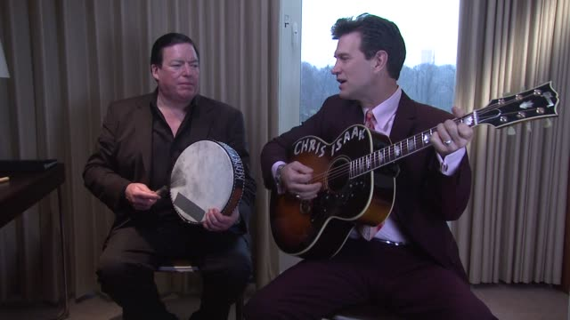 vídeos de stock, filmes e b-roll de isaak and kenny dale johnson singing the ring of fire at chris isaak interview the royal garden hotel on 24th january 2012 in london - chris isaak