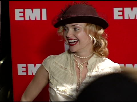 isabella amico and guest at the emi post-grammy awards bash at the beverly hilton in beverly hills, california on february 13, 2005. - emi grammy party stock videos & royalty-free footage