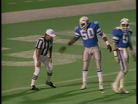 1985 montage ws isaiah west and other portland breakers players getting upset at referee over call/ ws portland breakers coach dick coury angrily pacing on sidelines during game against birmingham stallions/ portland, oregon - pallone da football americano video stock e b–roll