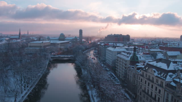 isarkanal, munich, winter, sunset - winter stock-videos und b-roll-filmmaterial