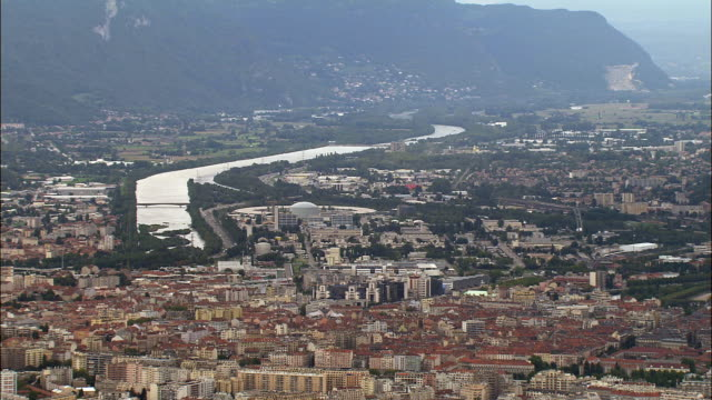 aerial ws isere river winding along cityscape / grenoble, france - grenoble stock-videos und b-roll-filmmaterial