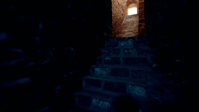 ishak pasha palace - climbing the stairs in dungeon - the light at the end of the tunnel - madressa stock videos and b-roll footage