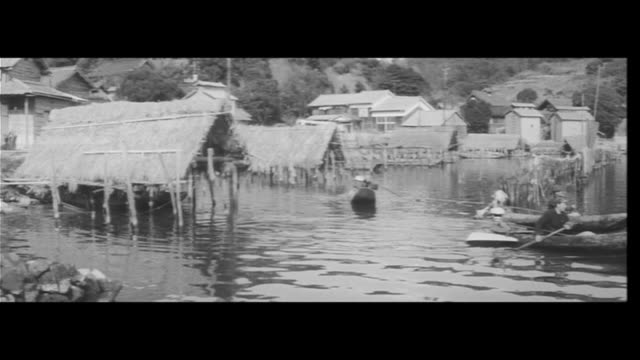 ishigama fishing/fishermen at a strategy meeting and with nets in hand, early morning, ship out, mountain of rocks piled up in the middle of the... - rice ball stock videos & royalty-free footage