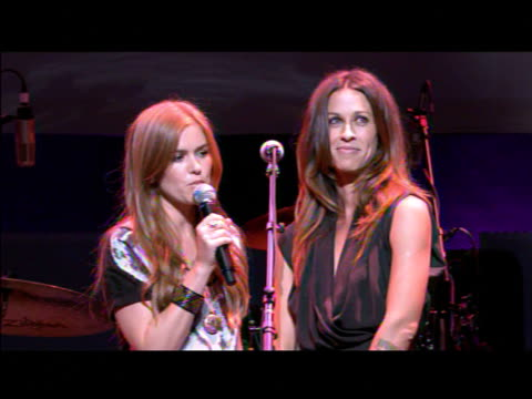 Isla Fisher Alanis Morissette on the event at the 'Rock A Little Feed A Lot' Benefit Concert at Los Angeles CA