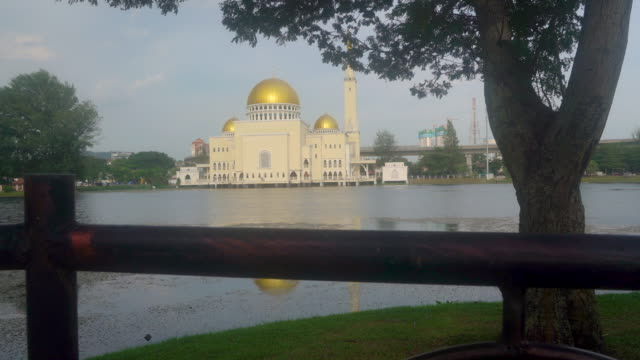islam mosque reflection on the lake - mosque stock videos & royalty-free footage