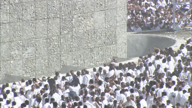 Islam pilgrims cast stones at the Jamarat  during the Stoning of the Devil ceremony at Mecca.
