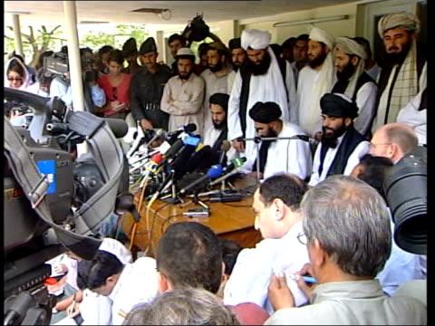 press gathered at taliban embassy pan taliban officials tgv press gathered outside embassy building cms side taliban officials taliban official... - jihad stock videos & royalty-free footage