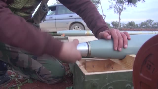 islamic front members attack the airports with grad missiles in order to prevent to be sending ammunitions to troops of assad regime forces by assad... - 武力攻撃点の映像素材/bロール