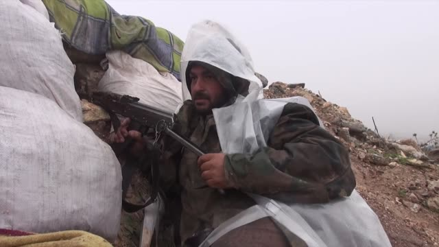 islamic front members still deploy to fight against regime forces although bad weather conditions in aleppo syria on 23 december 2014 islamic front... - hezbollah stock videos & royalty-free footage