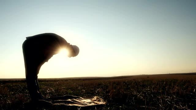 islamic man praying outdoors - ramadan stock videos & royalty-free footage