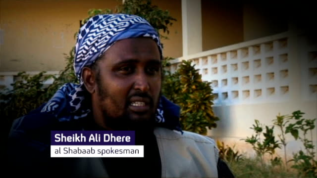 islamic militancy on the rise in africa still/graphic sheikh ali dhere phono interview sot if that's what he wants our war is a holy war for us the... - phono einzelwort stock-videos und b-roll-filmmaterial