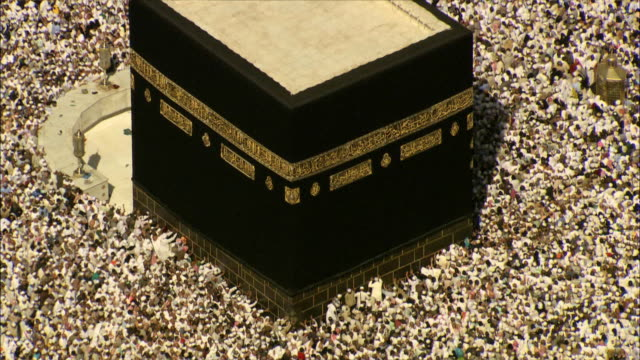 islamic pilgrims circle the kaaba in mecca. - mecca stock videos and b-roll footage