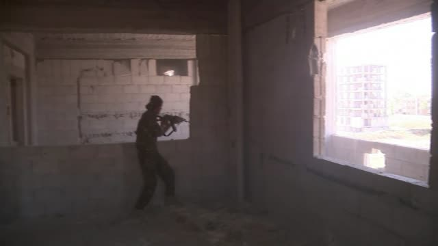 islamic state 'beatles' gang members seized by syrian kurdish fighters t05101701 / raqqa int kurdish rebel firing gun sot various of kurdish fighters... - kurdischer abstammung stock-videos und b-roll-filmmaterial