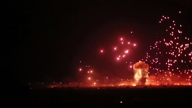 Islamic State fighters and civilians abandon last stronghold in Baghouz SYRIA Barghuz Explosion lighting up night sky during fighting