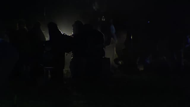 Islamic State fighters and their families surrendering to Kurdish forces in Baghuz Syria at night