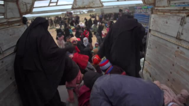 Islamic State fighters and their families surrendering to Kurdish forces in Baghuz Syria