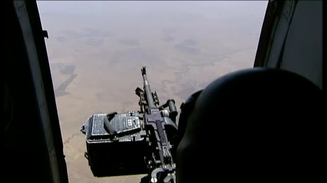 vídeos de stock e filmes b-roll de islamic state fighters make gains despite us airstrikes iraq soldier sitting in plane next to opening next to weapon air view river tigris and... - ataque aéreo