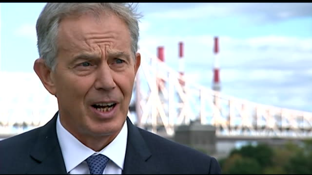 Tony Blair interview USA New York EXT Tony Blair walks along towards camera with aide and greeted by reporter/ Tony Blair interview SOT in danger of...