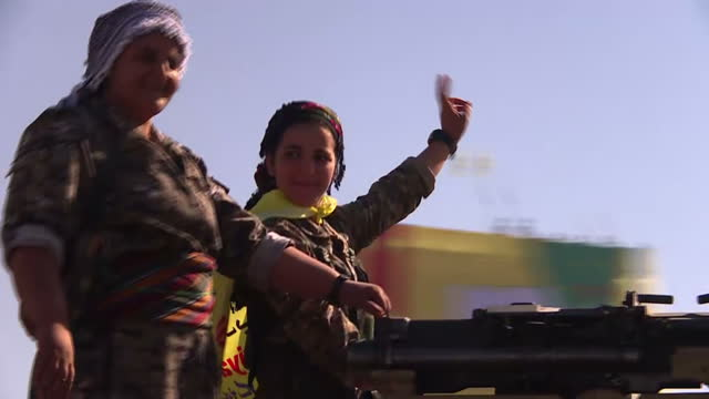 stockvideo's en b-roll-footage met islamic state's brutal reign of terror in raqqa may be at an end but as the liberation of the syrian city is celebrated in the streets the shadow of... - isis