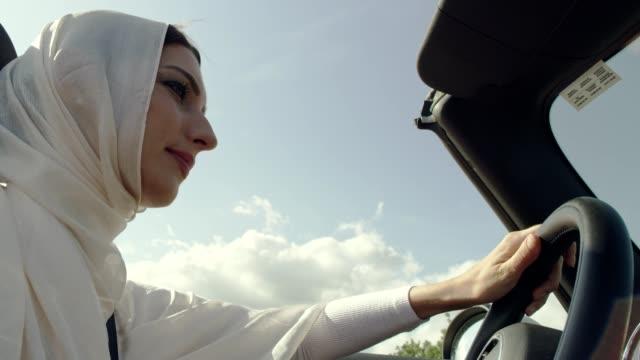 islamic woman driving cabrio car - cosmetics stock videos & royalty-free footage