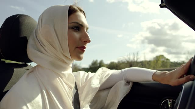 islamic woman driving cabrio car - middle eastern ethnicity stock videos & royalty-free footage
