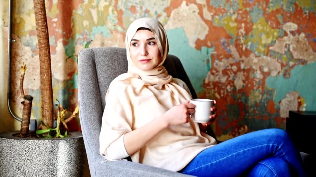 islamic woman with veil on the sofa - turkish ethnicity stock videos & royalty-free footage