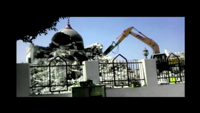 islamist hardliners bulldozed part of a revered mausoleum in tripoli on saturday in the second such attack in libya in two days tripoli libya - mausoleum stock videos and b-roll footage