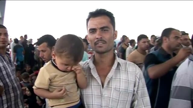 islamist rebels capture city of tikrit irbil / erbil various of queues of cars and civilians at border checkpoint at crossing into kurdish region... - isil conflict stock videos & royalty-free footage