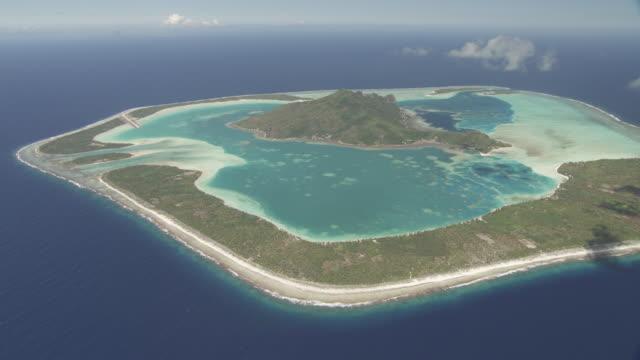 Island atoll with shallow tropical lagoon, Maupiti, French Polynesia
