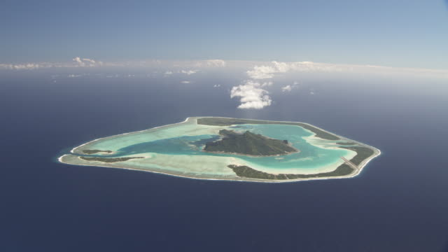 Island atoll with shallow tropical lagoon, Maupiti, French Polynesia