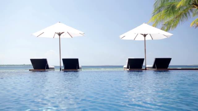 vídeos y material grabado en eventos de stock de island beach pool - tumbona