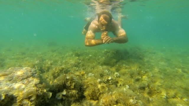 island getaway: man swim in slow motion - adriatic sea stock videos & royalty-free footage