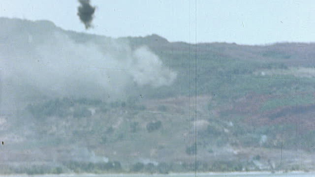 island warfare with destroyer bombarding shore facilities with fiveinch naval guns and planes bombing / saipan mariana islands - mariana islands stock videos and b-roll footage