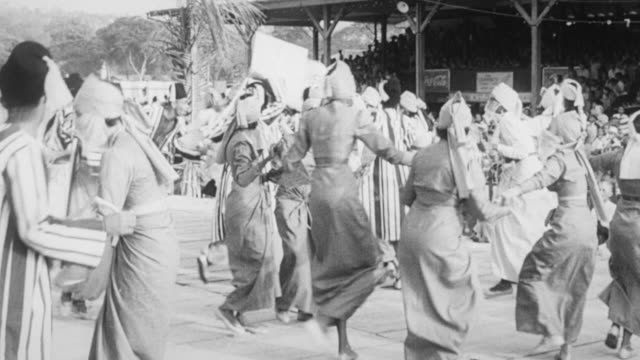 1948 montage islanders dancing at parade / consumers walking into co-operative building / fishing and credit society inspector meeting with members / discovery bay, jamaica, west indies - jamaica stock videos and b-roll footage