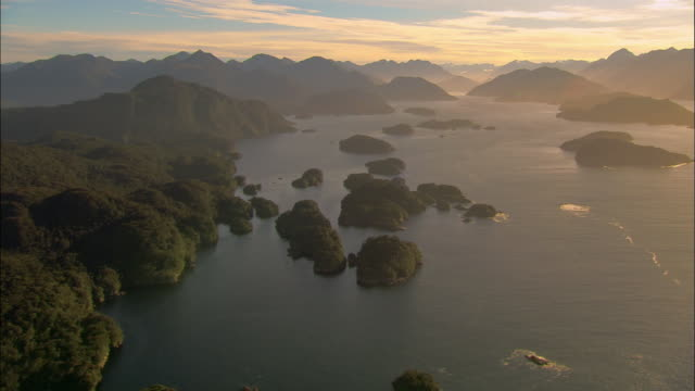 aerial, islands, fiordland national park, new zealand - national park stock videos & royalty-free footage