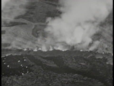 stockvideo's en b-roll-footage met islands w/ volcanic activity smoke smoking mountain low altitude ws mount suribachi at tip of iwo jima passing iwo jima - iwo jima