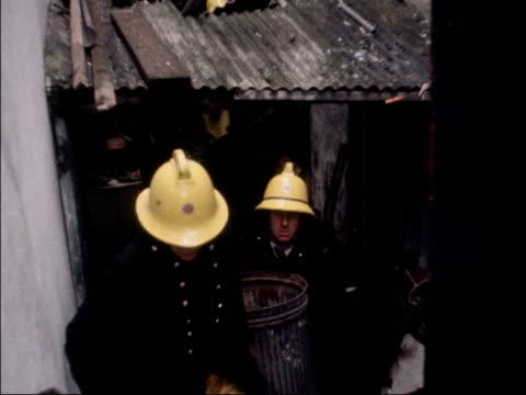 isle of man boarding house fire kills four isle of man douglas ext pan boarding house firemen carry out bin pan window burnt window burnt roof... - isle of man stock videos & royalty-free footage
