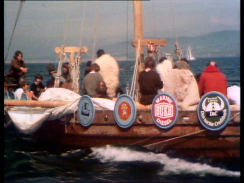 airv longship ms sheepskin coat on crewman cms shields on side of ship tms radio tilt ms crew zoom tms one horn sof helmet zoom ms longship lr zoom... - viking helmet stock videos and b-roll footage