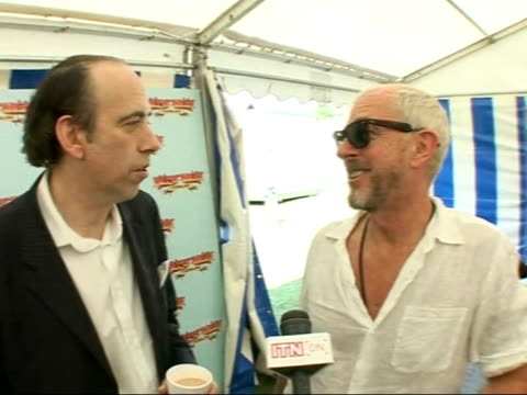 Ash and Kasabian interviews / Amy Winehouse walking ENGLAND Isle of Wight Seaclose Park INT General views of band members from Ash from LR Rick...