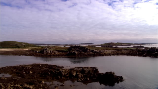 low aerial, isles of scilly, england - isles of scilly stock videos & royalty-free footage