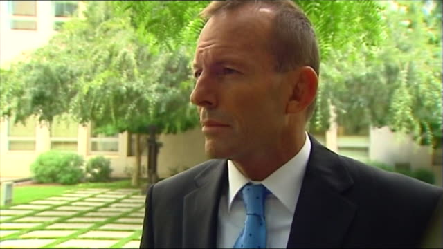 """iso Opposition Leader Tony Abbott watches video hear '""""shit happens'"""" comment / 7 news reporter Mark Riley interview with Abbott re his 'Shit..."""