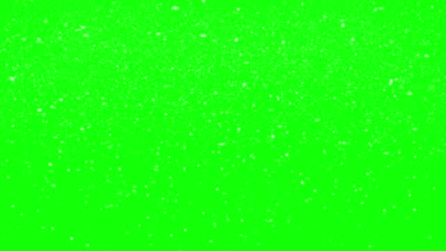 vidéos et rushes de neige tombante isolée sur l'écran vert avec des flocons de neige abstraits formes 4k loopable stock vidéo - multi layered effect