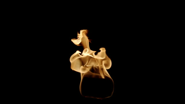 isolated flame of torch shot on black - flaming torch stock videos & royalty-free footage