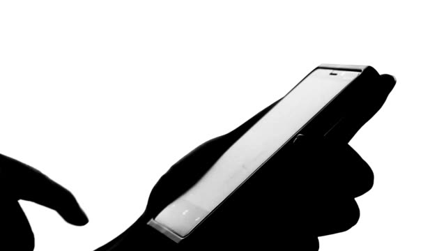 isolated:Typing smart phone Silhouette