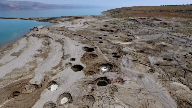 israel, aerial view of the dead with sinkholes near the dead sea, formed by dissolution of underground salt - israel stock videos & royalty-free footage