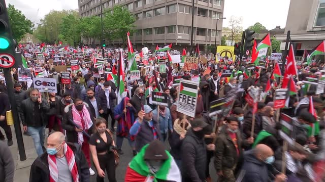 israel destroys gaza tower block housing international media organisations / pro-palestine protest march in london; uk, london; general views of... - marching stock videos & royalty-free footage